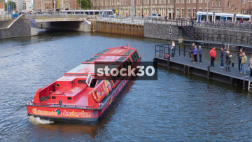 Cruise Boat Manoeuvering On River Near Centraal Station In Amsterdam, Netherlands