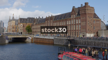 Wide Shot Of Amsterdam Centraal Station And River, Netherlands