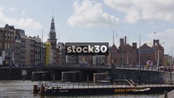 Tram Crossing Bridge Over Amstel River Near Amsterdam Centraal Railway Station, Netherlands