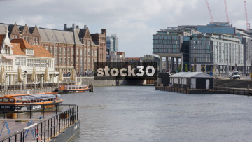 Wide Shot Of River In Amsterdam With Cruise Boats, Netherlands