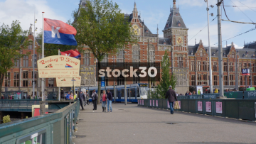 Slow Motion Wide Shot Of Amsterdam Centraal Railway Station With Passing Tram, Netherlands