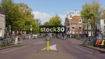 Street In Amsterdam With Cyclists, Pedestrians And Cars, Netherlands