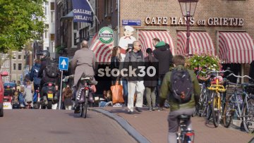 Slow Motion Shot Of Cyclists And Pedestrians On Street In Amsterdam, Netherlands