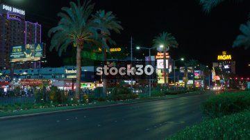Traffic Passing By Near Polo Towers And MGM Grand On Las Vegas Boulevard, USA