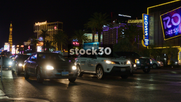 Traffic Passing By Near Planet Hollywood On Las Vegas Boulevard, USA