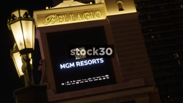 Bellagio Hotel Sign In Las Vegas, Night Then Day Time, USA
