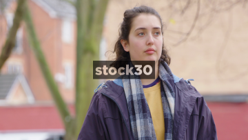 Depressed And Worried Young Woman Standing Outside - Close Up