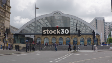 Liverpool Lime Street Station With Passing Pedestrians And Traffic, UK
