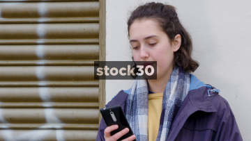 Young Woman Texting With Smart Phone