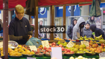Fruit Sellers Bagging Fruit On Northampton Market, UK