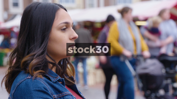Serious Looking Young Woman Sitting And Contemplating