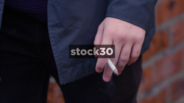 Close Up Shots Of Hand With Cigarette