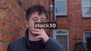 Slow Motion Shot Of Young Man Smoking A Cigarette