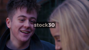 Slow Motion Shot Of Young Man Laughing And Smiling With His Girlfriend