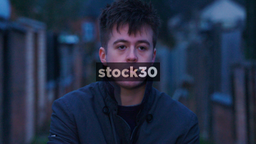Close Up Slow Motion Shot Of Young Man Smoking Cigarette In Alleyway