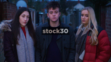 Slow Motion Shot Of Three Young People With Attitude Standing In Alleyway