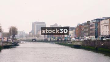 View over River Liffey In Dublin With Millennium Bridge In Background, Ireland