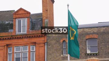 Slow Motion Shot Of Green Harp Flag In Dublin, Ireland