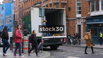 Man Loading Metal Beer Kegs Into Van In Dublin, Ireland