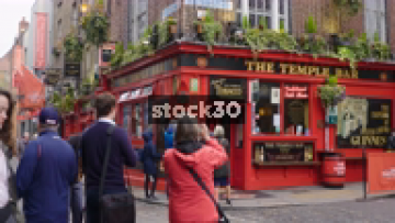 The Temple Bar Pub In Dublin - Wide Shot Followed By Close Up On Sign, Ireland