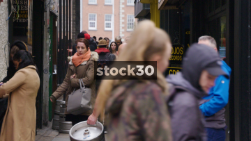 Slow Motion Shot Of Man Carrying Beer Kegs Down Busy Alleyway In Temple Bar, Dublin, Ireland