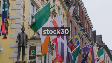 Slow Motion Shot Of Various Flags Outside The Oliver St.John Gogarty Irish Pub In Temple Bar, Dublin, Ireland