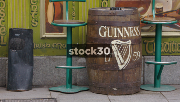 People Walking Past Traditional Beer Barrels In Temple Bar, Dublin, Ireland