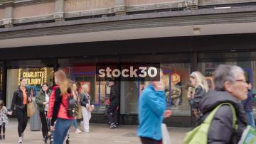Shoppers Passing Arnotts Department Store On Henry Street In Dublin, Ireland