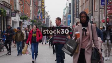 Shoppers Walking Down Busy Henry Street In Dublin, Ireland