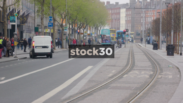 Tram Passing By On O'Connell Street Lower In Dublin, Ireland
