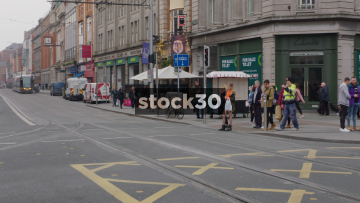 Two Shots Of Trams Passing By In Dublin City Centre, Ireland