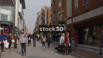 Slow Motion Shot Of Shoppers On Henry Street With Spire Of Dublin In Background, Ireland