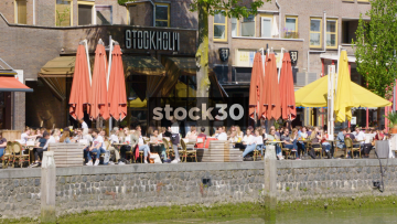 People Drinking And Dining Outside Stockholm Bar In Rotterdam, Netherlands