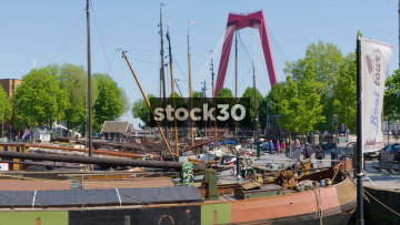 Various Boats Moored Near Willemsbrug Bridge In Rotterdam, Netherlands
