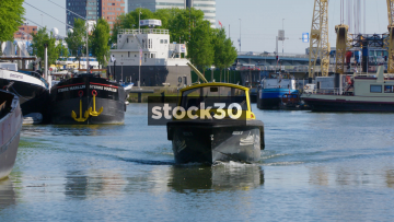 Water Taxi Arriving On Canal In Rotterdam, Netherlands