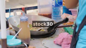 A Street Food Vendor Preparing Food In Bangkok, Thailand