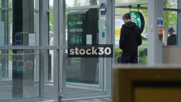 Slow Motion Shot Of Busy Motorway Services Entrance, UK
