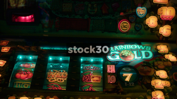 Close Up Then Panning Shot Of Gambling Machines, UK