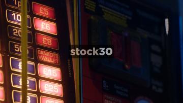 Close Ups Shots Of Gambling Machine Being Played, UK