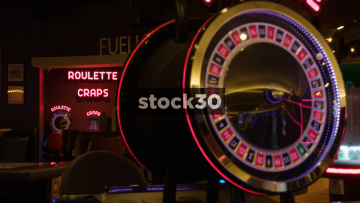 Focus Pull From Roulette And Craps Sign To Roulette Game In Casino