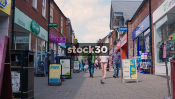 Slow Motion Shot Of Shoppers On Castle Walk In Newcastle Under Lyme, UK