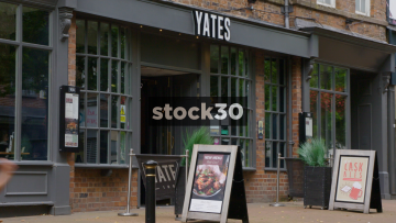 Yates Pub With Passing Pedestrians On Ironmarket In Newcastle Under Lyme, UK
