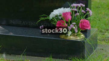 Flowers On Grave In Cemetery