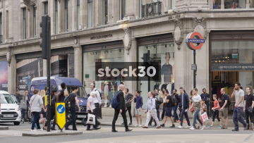 Slow Motion Shot Of Pedestrians Crossing on Oxford Circus In London, UK