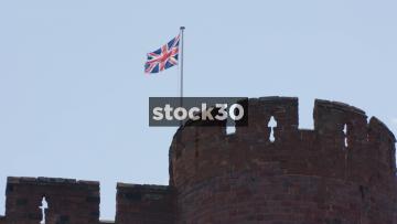 Slow Motion Shot Of Union Jack Flag Flying On Shrewsbury Castle, UK