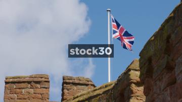 Slow Motion Shot Of Union Jack Flag On Top Of Shrewsbury Castle, UK