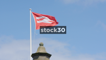 Slow Motion Shot Of National Rail Flag, UK