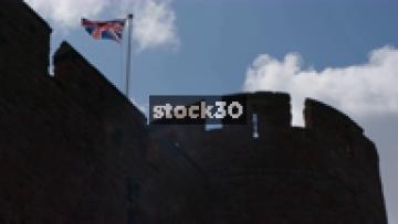 Slow Motion Shot Of Union Jack Flag Blowing On Top Of Shrewsbury Castle, UK