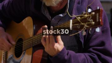 Busker Playing Guitar In Shrewsbury, Close Up, UK