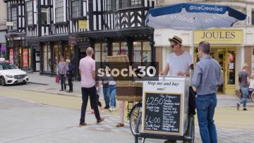 Man Buying Ice Cream From Vendor In Shrewsbury, UK